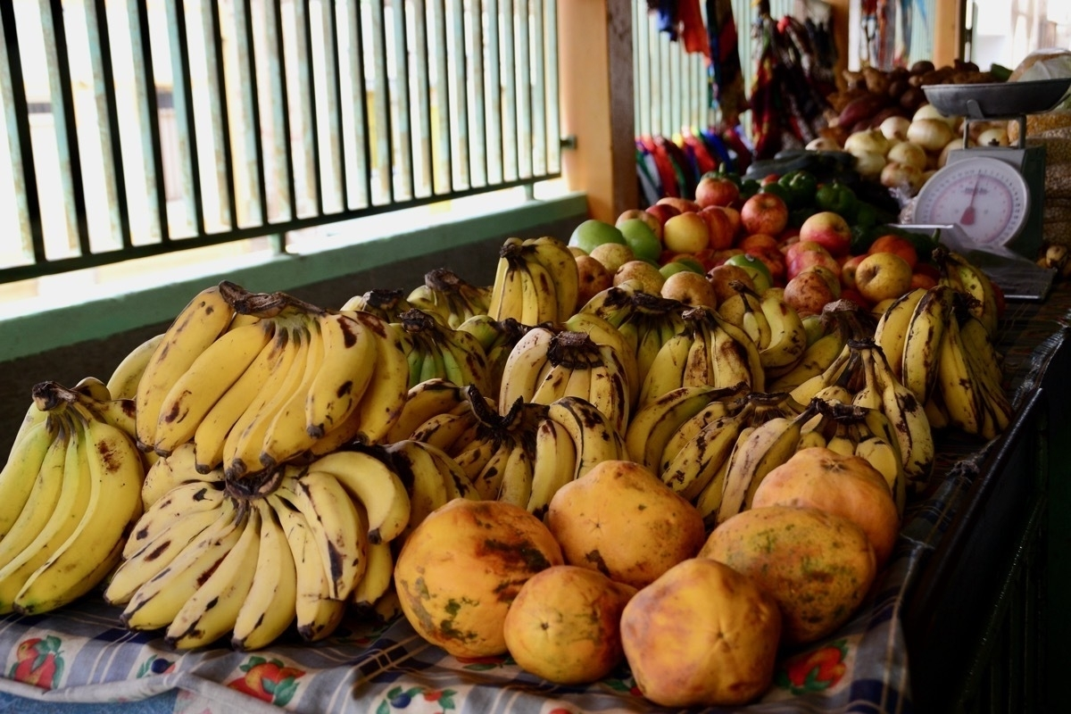Bananas and other fruit on a market stall